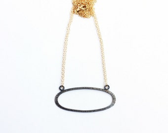 LIGNE horizontal oval pendant necklace in oxidized recycled silver and gold