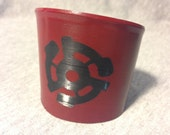 Upcycled Vinyl Record Cuff with 45 Adapter Design- Red Stencil on Black Vinyl