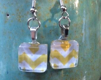 Charming handmade dangle earrings with silver findings. Yellow chevron