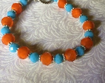 Orange and Turquoise Colored Bead Bracelet. Silver Accents.