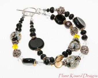 CoCo. Handcrafted Lampwork Glass Bead Bracelet.
