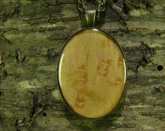 Birdseye Maple wood, resin encased in antique brass finish pendant bezel with chain