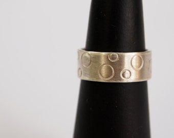 Handmade sterling silver ring with matte finish and circles designs