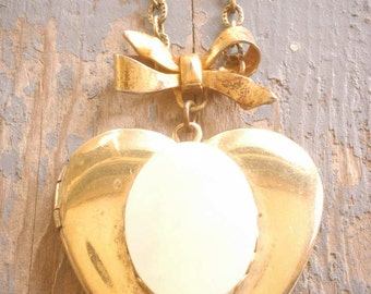 heart of gold locket necklace. large vintage locket with mother-of-pearl on antique brass bow and etched chain. ooak by val b.