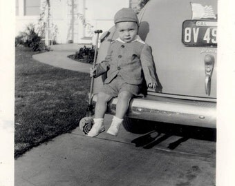 vintage photo Darling Little Boy Holds Roly Poly Toy sits on Pymouth Car 1940s
