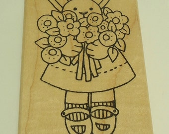 Rabbit Holding Flowers Wood Mounted Rubber Stamp by Azadi Earles G743