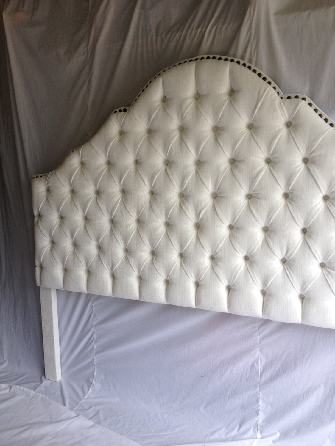 king size tufted headboard with a row of brass nailheads. Black Bedroom Furniture Sets. Home Design Ideas