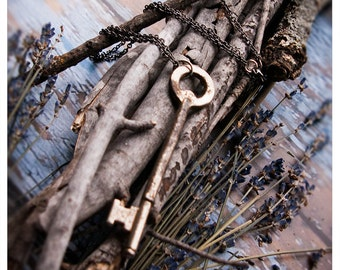 vintage skeleton key necklace - the mocata key- skeleton key held captive by chain in shades of gunmetal