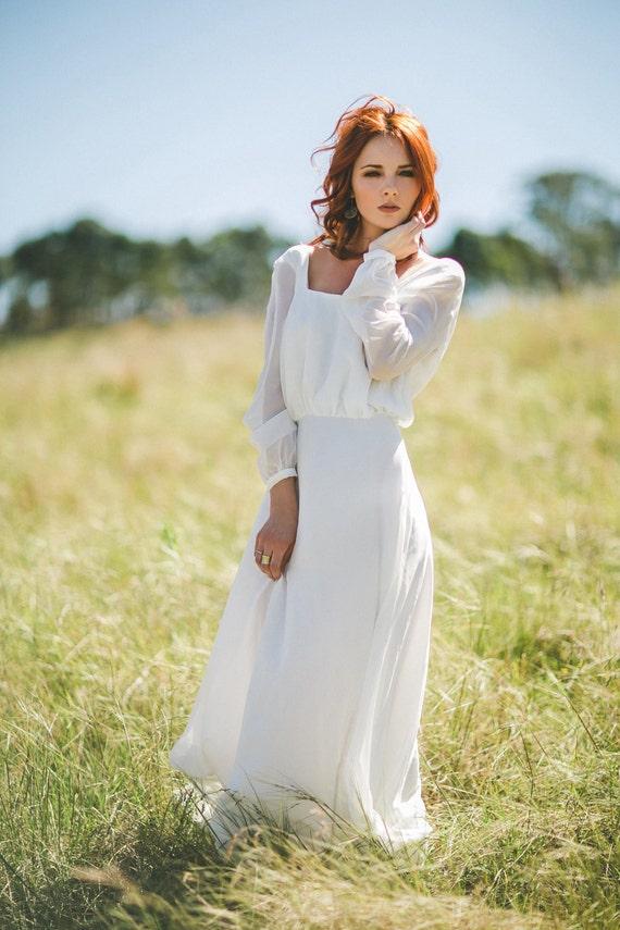 White long sleeve flowing dress.