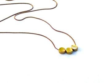 Triple gold dot necklace