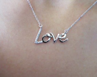 14k White gold LOVE diamond pendent