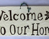 Welcome to our Home tile in black and white