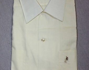 vintage 50's - 60's -Manhattan- Men's short sleeve - button loop collar shirt. 'New Old Stock'. Pale Yellow w/ embroidered pocket. Large