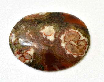 Flowering jasper cabochon.  large oval 37 x 29 x 5.4