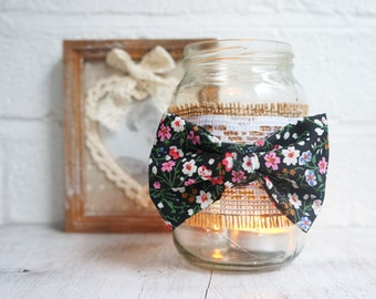 Jam jar candle holder with cath kidston style bow decoration.