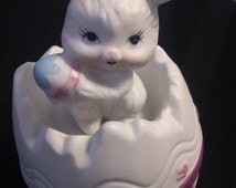 Vintage hand-painted ceramic Bunny figurine seated in giant Easter Egg