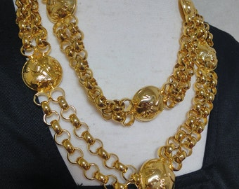 MINT. Vintage Salvatore Ferragamo chain belt with golden round charms of shoes. Can be worn as a necklace.