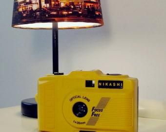 Vintage Nikashi Camera Lomo Retro style in black and yellow color