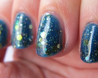Save the Princess Nail Polish - deep blue jelly with gold and silver glitter