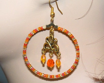 Orange Beaded Hoop Earrings with  Beaded and Antique Brass Dangling Charm