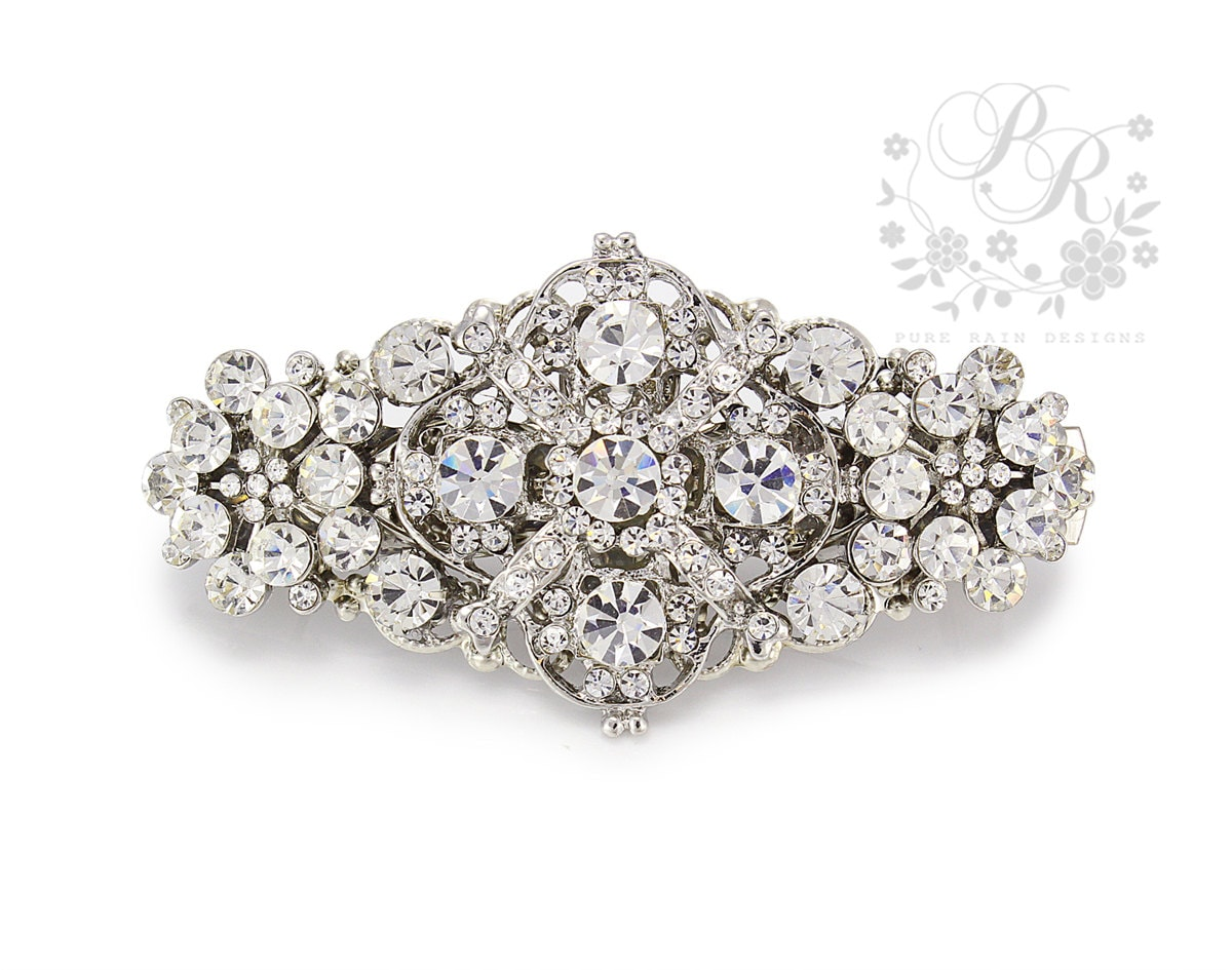Add rhinestone flower hair accessories to any hair style to give it a striking unique look that no other hair accessories can achieve. You can choose something small such a barrette or go somewhat larger with a stunning hair clip.