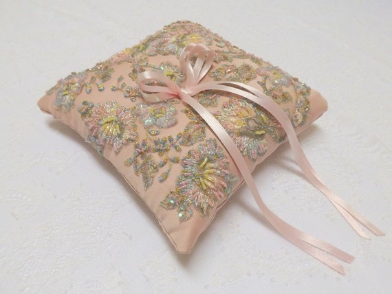 Wedding ring pillow. Antique pink ring bearer decorated with multicolor lace flowers embroidery.