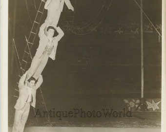 Circus acrobats men on shoulders balancing act vintage photo Ringling Brothers