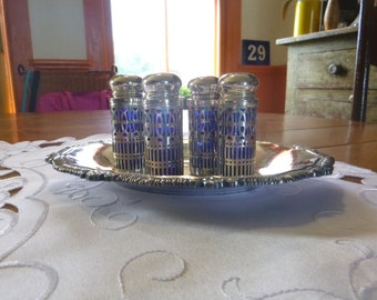 4 Silverplate Shakers with Cobalt glass