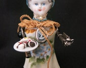 China assemblage doll.  Victorian porcelain salt shaker body, old key arms, handmade lace and tatting, petite fours and tea pot.