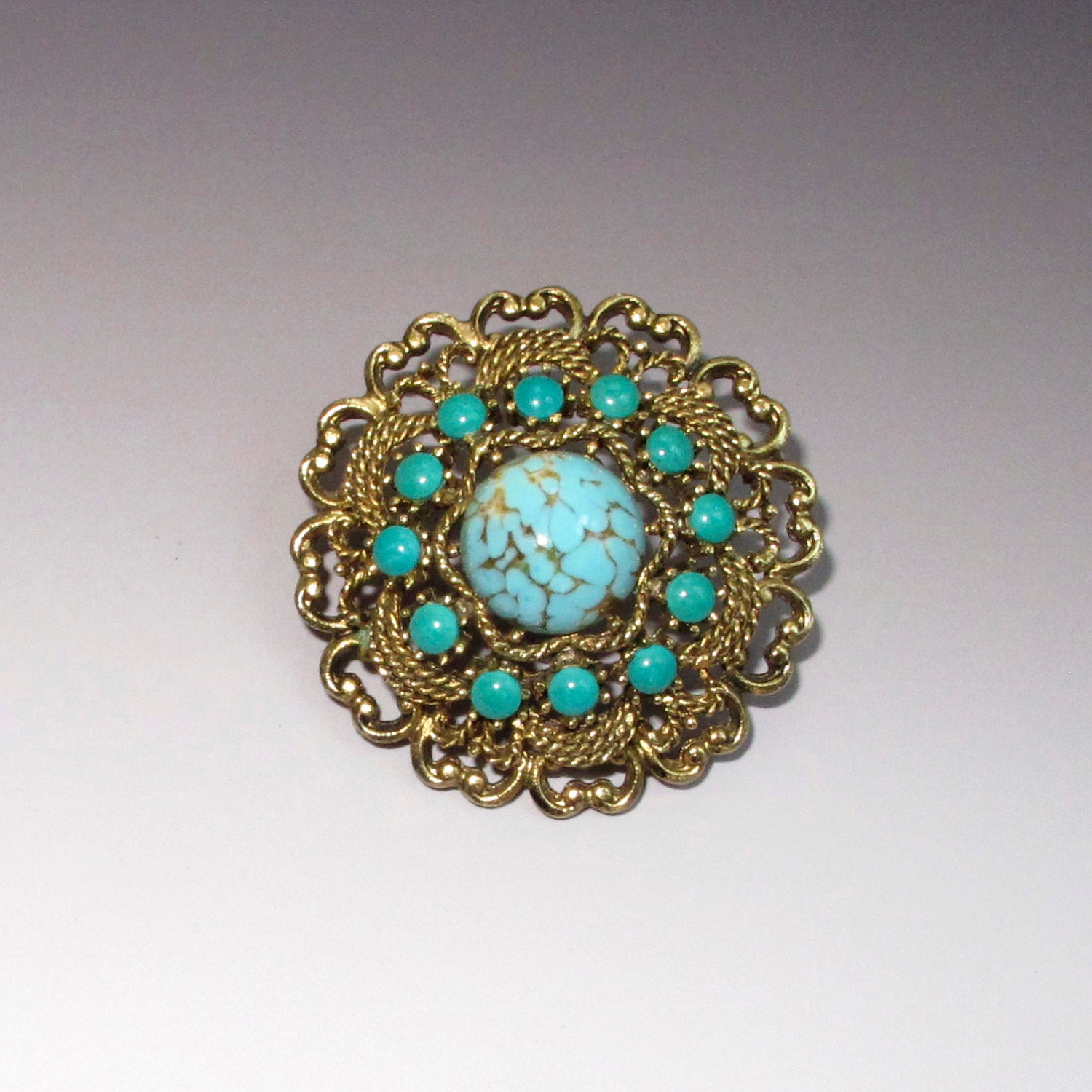 vintage emmons faux turquoise and antique goldtone brooch