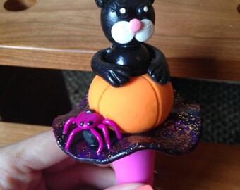 black cat in a pumpkin wine stopper
