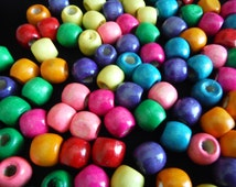 Popular items for colored wood beads on etsy for Wholesale craft supplies for resale