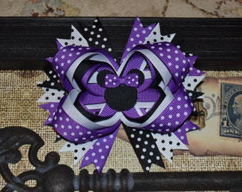 "Purple Minnie Mouse Hair Bow 5"" attached to an alligator clip."