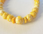 Modern, Chic, Classic,  Yellow  Short Beaded Necklace.  Length 24 cm.