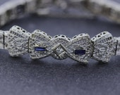 Double Bow Platinum plated 14K Gold  Hinged Filigree Bracelet with Sapphires and Diamonds