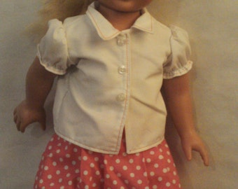 White blouse with pink polka dot pleated skirt that fits 18 inch doll.