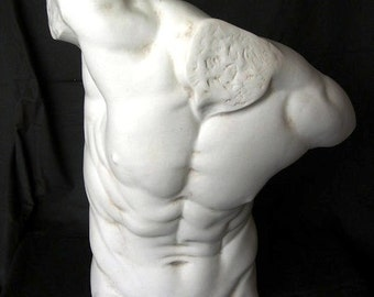 MALE TORSO – A large marble sculpture of a naked male torso.