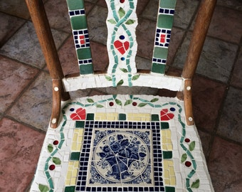 Broken ceramic tile covered wooden chair