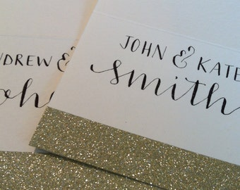 Set of 50 personalized gold glitter place cards