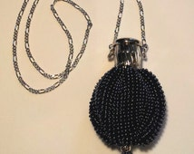 The Charlotte, a gate-top necklace purse amulet bag