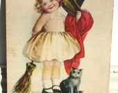 Vintage Halloween Postcard of a sweet little girl with a witch costume, black hat broom and a black cat from The Rose Company
