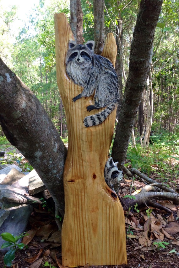 Two raccoons in tree chainsaw wood carving by oceanarts