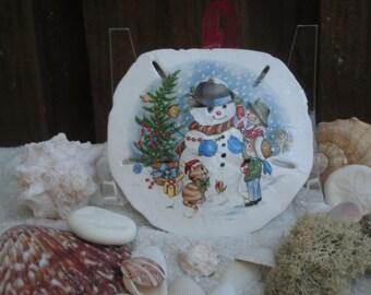 Handmade sand dollar Christmas ornament featuring a beautiful