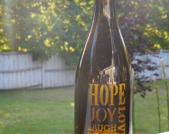 "Wine bottle hurricane lantern with etching, ""Hope,Joy,Love,Laugh,Peace"""