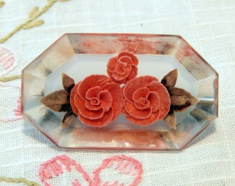 Lovely rectangular octagon lucite brooch, reverse carved with roses