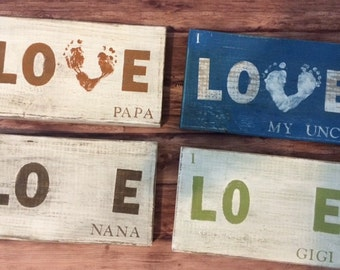 "Personalized ""LOVE"" baby footprint sign."