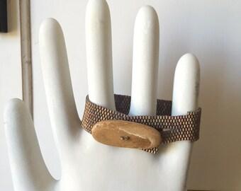 Beach stone fastened beaded bracelet