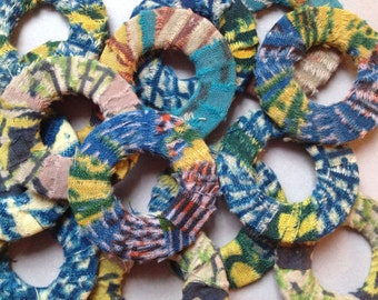 14 rings handmade in ancient African loincloths. Colors: blue, green, yellow