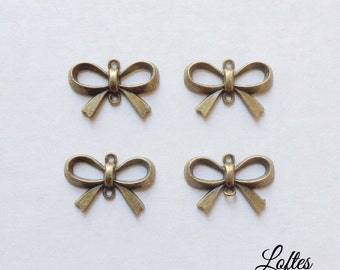 8 bow connector charms - BCB100