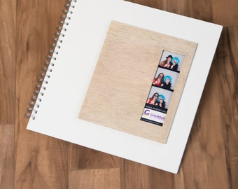 photo booth scrap book with white mat and natural wood frame 12x12